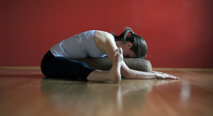 Restorative Forward Fold with Props to help restore the body to rest-and-digest mode