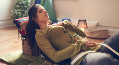 Serene lady relaxing and meditating as preparation for a great night's sleep