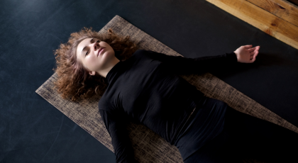 The benefits of practicing Savasana restorative yoga pose to reduce stress and improve sleep