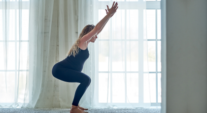 Pregnant woman practicing utkatasana