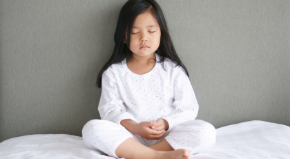 Child practicing yoga meditation ayurveda