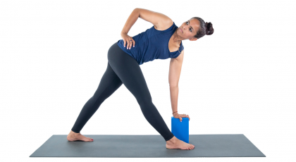 woman practicing yoga, revolved triangle pose