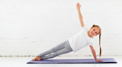 Child practicing Side Plank Pose (Vasisthasana)