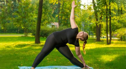 Woman practicing yoga Triangle pose (Utthita Trikonasana)