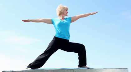 Yoga woman for heart health in Warrior II Pose (Virabhadrasana II)