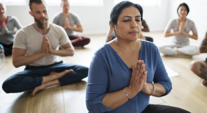 Yoga class practicing soothing poses for fibromyalgia pain