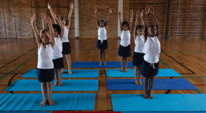 Kid's yoga class in Mountain Pose (Tadasana)