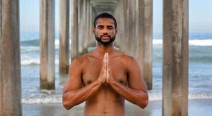 Man practicing yoga for sleep and body clock