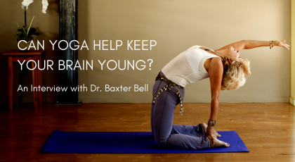 A woman in a variation of Camel Pose (Utrasana), practicing yoga to help keep the brain young