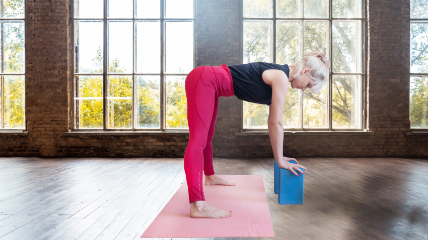 Yoga practice tips for spine-healthy forward bends in Wide-Legged Forward Bend Pose