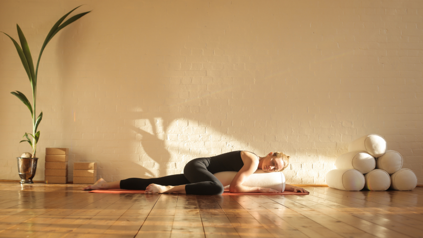 practicing restorative yoga is great way to prepare for a good night's sleep