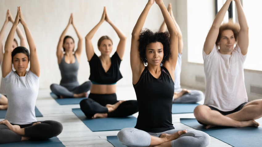 Yoga class practicing Easy Lotus Pose to aid in understanding racism and prejudice in America
