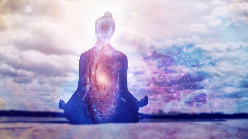 Human body seated in meditation, filled with the cosmos.
