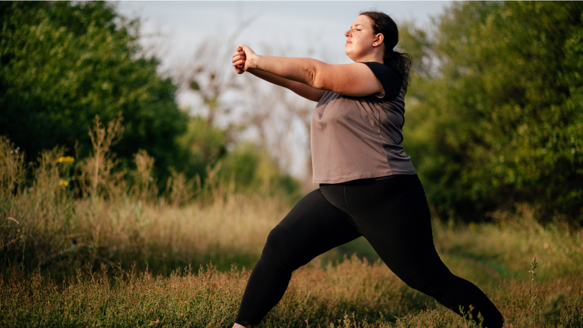 Woman practicing yoga for back pain lunge arm stretch