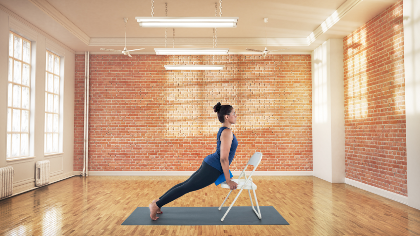 woman practicing accessible yoga with prop modifications