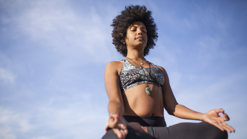 yoga woman cultivating gratitude in meditation pose