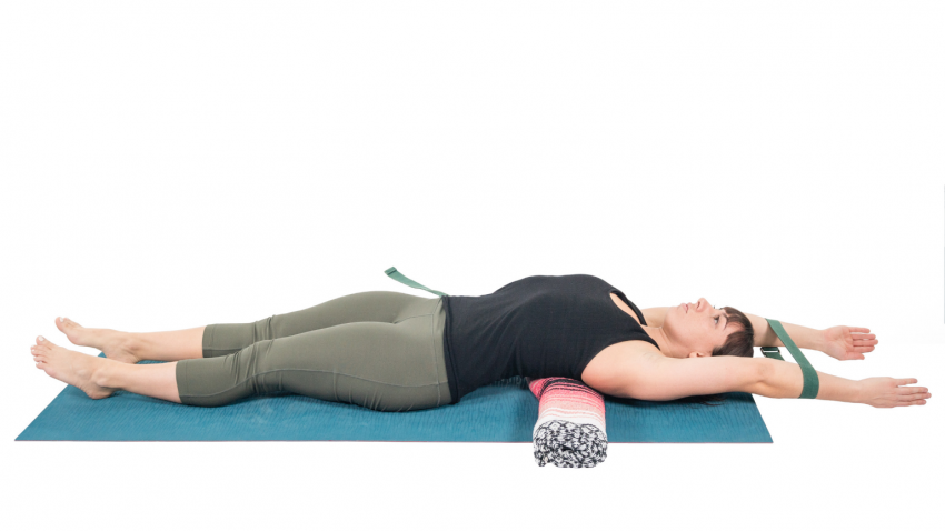 woman practicing yoga on floor to stretch computer body