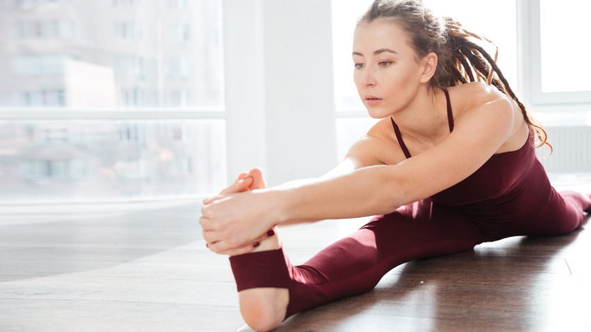 Woman practicing somatic yoga, more than stretching