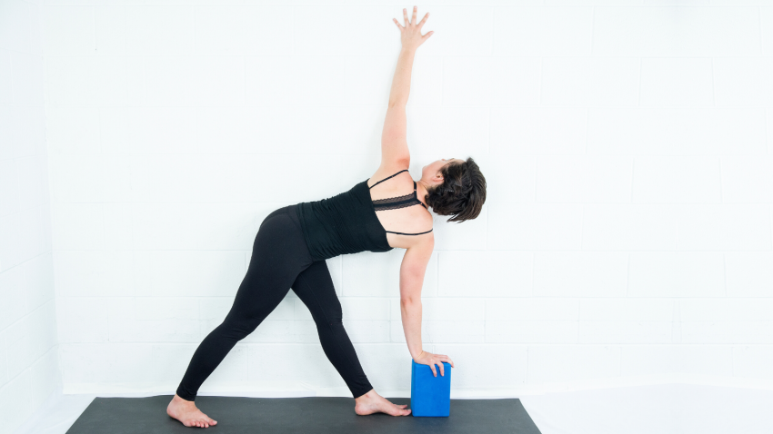 Stabilize And Twist Take Revolved Triangle Pose To The Wall Yogauonline