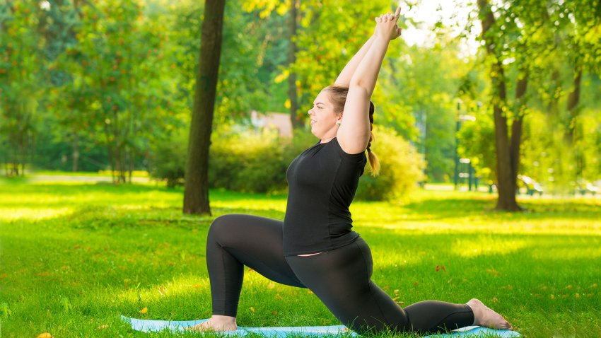 Woman practicing yoga for back pain Low Lunge Pose (Anjaneyasana)
