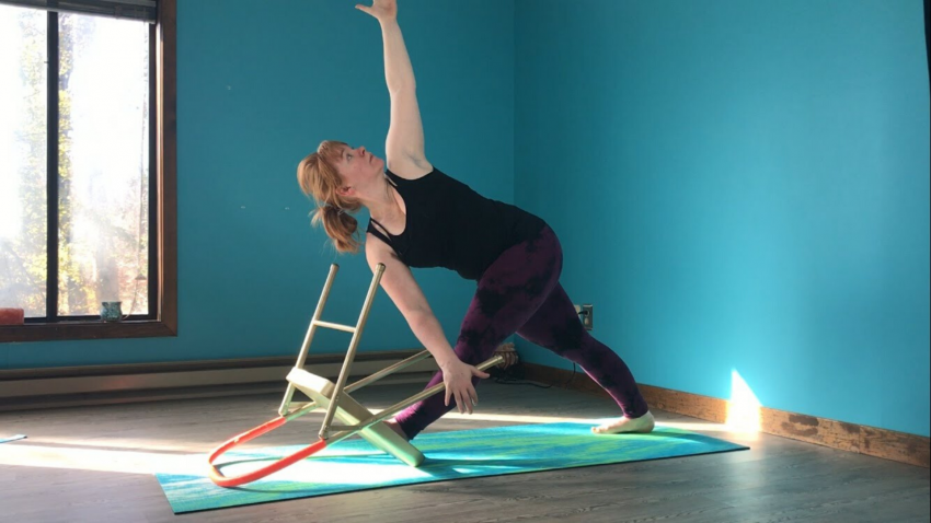 Woman practicing yoga Revolved Triangle