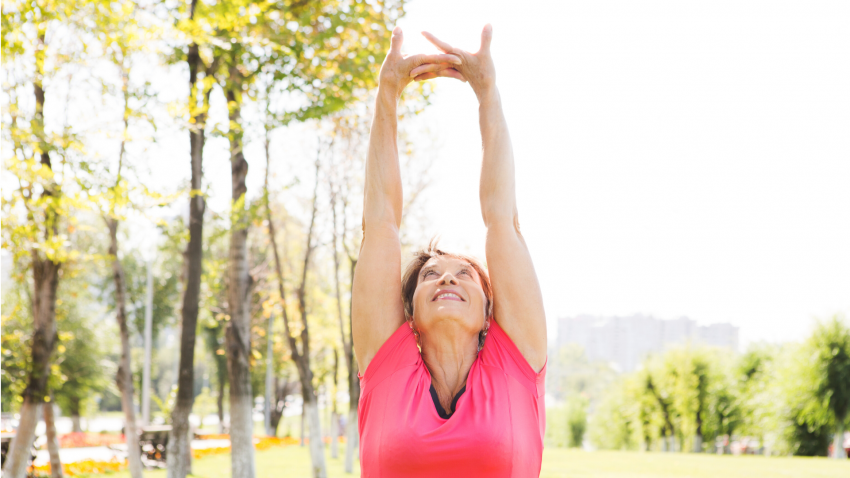 Older woman practicing yoga for arthritis relief