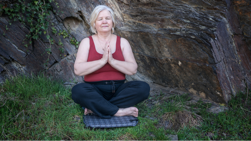Woman practicing yoga in seated pose the 5 koshas