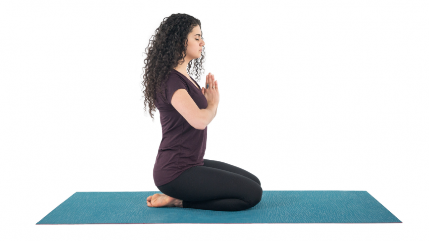 young woman practicing yoga hero's pose, Virasana