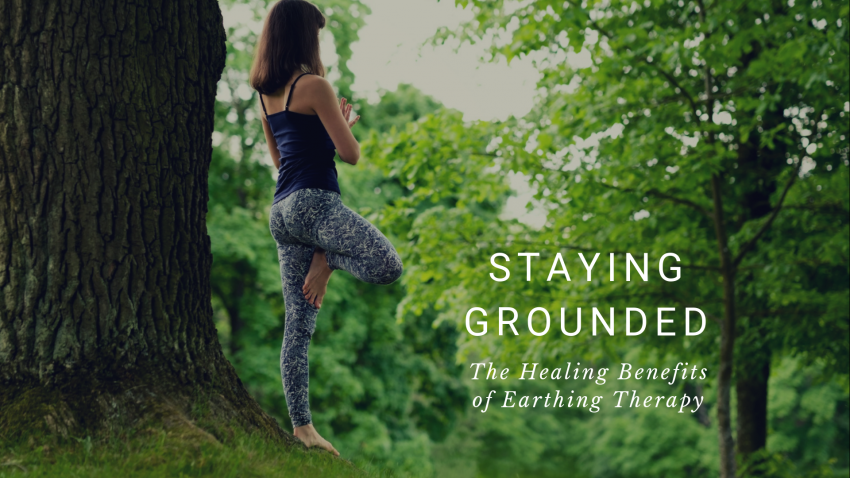 """A woman practicing Tree Pose (Vriksasana), practicing yoga while connected to the earth, called """"earthing"""" or """"grounding"""""""