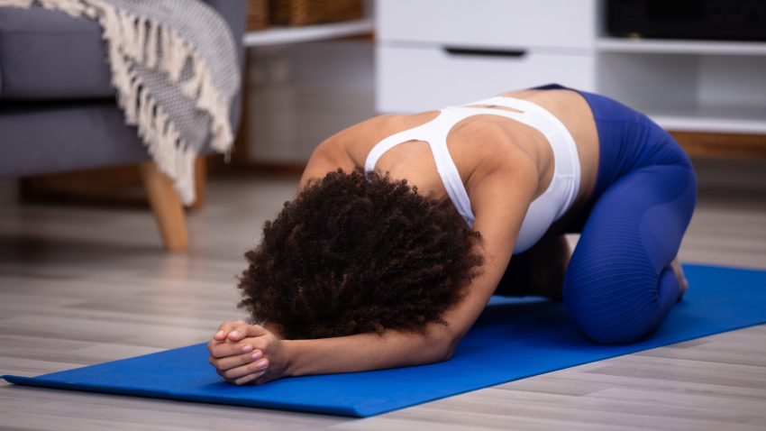 Woman in Child's Pose (Balasana) yoga for low back pain