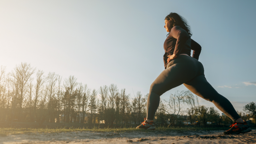 Woman practicing outdoor yoga in a Lunge Pose