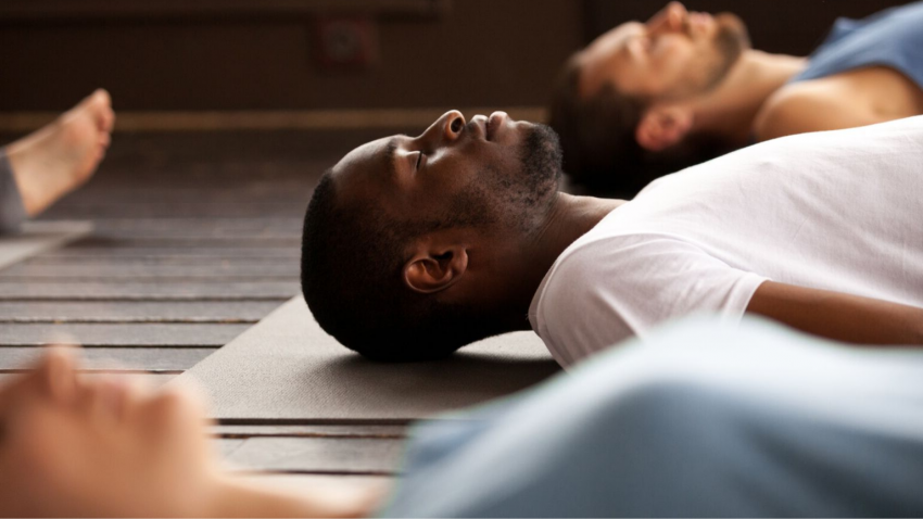 yoga men doing savasana
