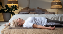 How to use a yoga eye pillow to support the neck in Corpse Pose (Savasana) for rest and relaxation