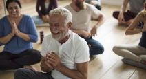 Older man practicing yoga for healthy aging
