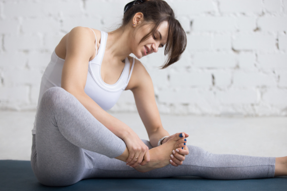 Yoga student experiencing pain in her foot